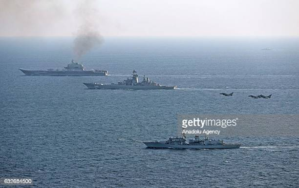 Jets belonging to Royal Air Forces and warships belonging to Royal British navy shadow Russian ships as they transit close to UK sovereign waters in...