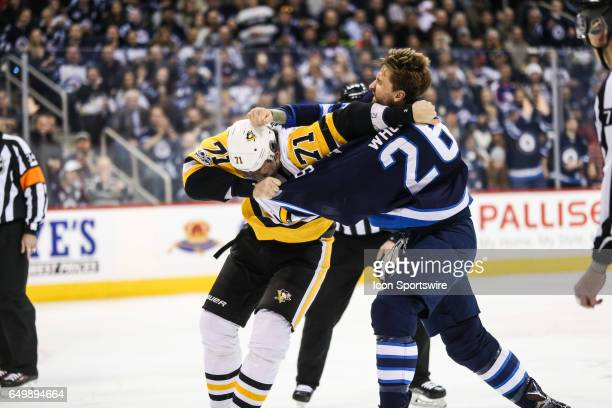 Jets Blake Wheeler squares off against Penguins Evgeni Malkin during the NHL game between the Winnipeg Jets and the Pittsburg Penguins on March 8...