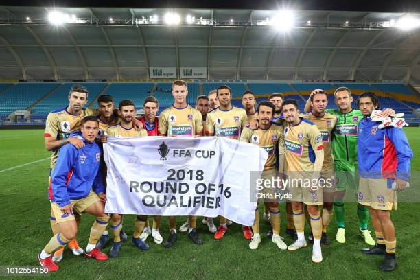 Jets celebrate winning the FFA Cup round of 32 match between Gold Coast Knights and Newcastle Jets at Cbus Stadium on August 7, 2018 in Gold Coast,...