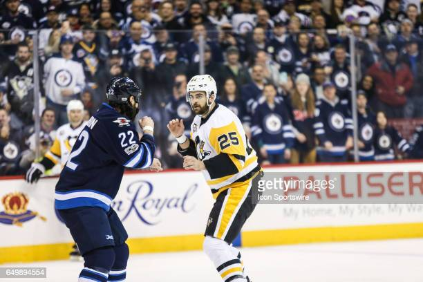 Jets Cliff Thorburn squares off against Penguins Tom Sestito during the NHL game between the Winnipeg Jets and the Pittsburg Penguins on March 8 2017...