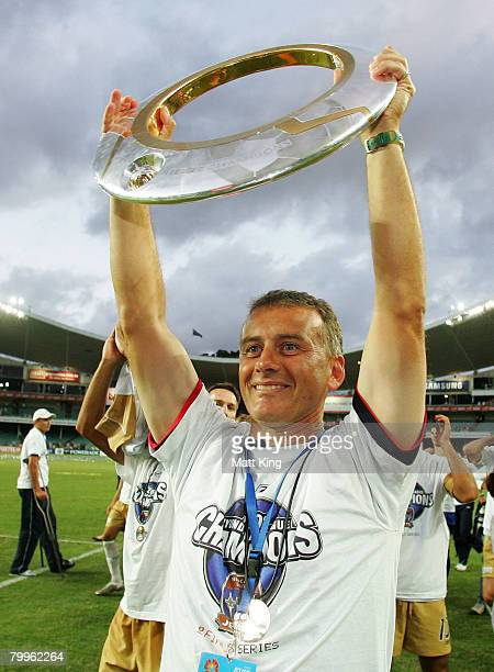 Jets coach Gary Van Egmond holds up the ALeague trophy after the ALeague Grand Final match between the Central Coast Mariners and the Newcastle Jets...