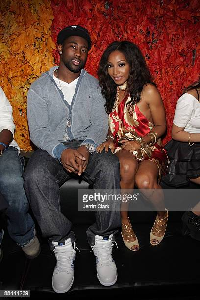 Jets Cornerback Darrelle Revis and Singer Wynter Gordon attend The Dejene Agency launch party at Greenhouse on June 11 2009 in New York City