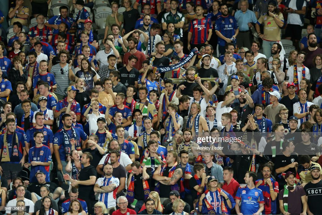 Jets fans celebrate the win during the round 27 A-League match between the Central Coast Mariners and the Newcastle Jets at Central Coast Stadium on April 14, 2018 in Gosford, Australia.