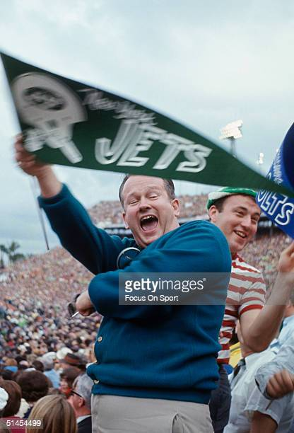 Jets fans wave their hands and a flag during Super Bowl III featuring the Baltimore Colts and the New York Jets at the Orange Bowl on January 12 1969...
