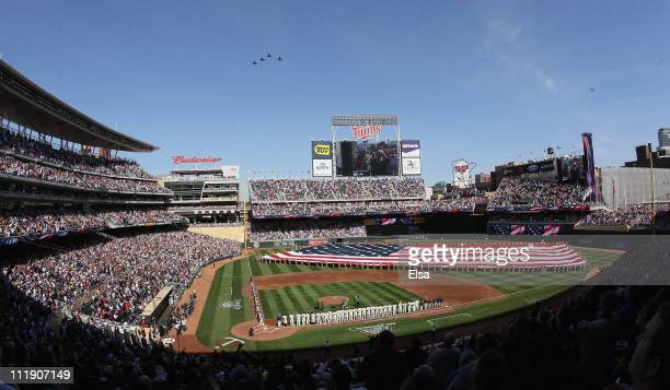 F16 jets fly over during the national anthem before the game between the Minnesota Twins and the Oakland Athletics during Opening Day on April 8 2011...