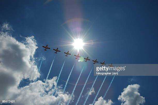 jets flying in sky leaving smoke trail, low angle view - canadian snowbird stock pictures, royalty-free photos & images