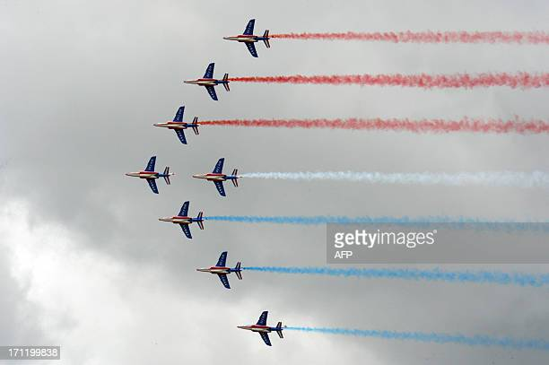 "Jets from the French Air Force precision flying team ""La Patrouille de France"" perform their flying display at Le Bourget airport, near Paris on June..."