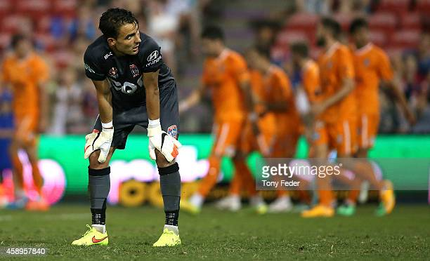 Jets goalkeeper Mark Birighitti looks dejected after conceding a goal during the round six ALeague match between the Newcastle Jets and Brisbane Roar...