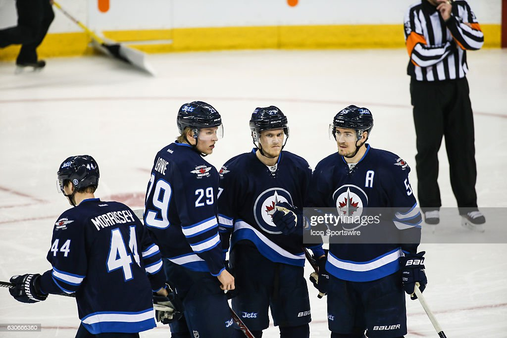 Jets Patrik Laine (29) confers with Nikolaj Ehlers (27) and Mark Scheifele (55) during the NHL game between the Winnipeg Jets and the Columbus Blue Jackets on December 29, 2016 at the MTS Centre in Winnipeg MB.