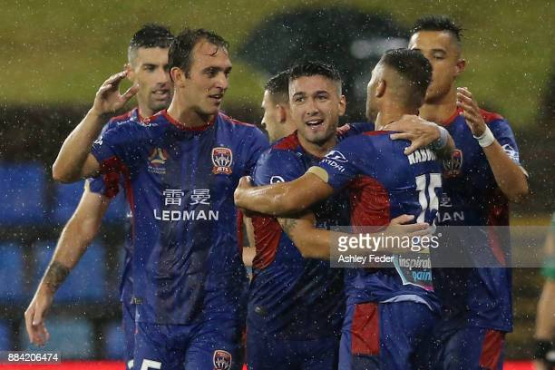Jets players celebrate a goal by Andrew Nabbout during the round nine ALeague match between the Newcastle Jets and Melbourne City at McDonald Jones...