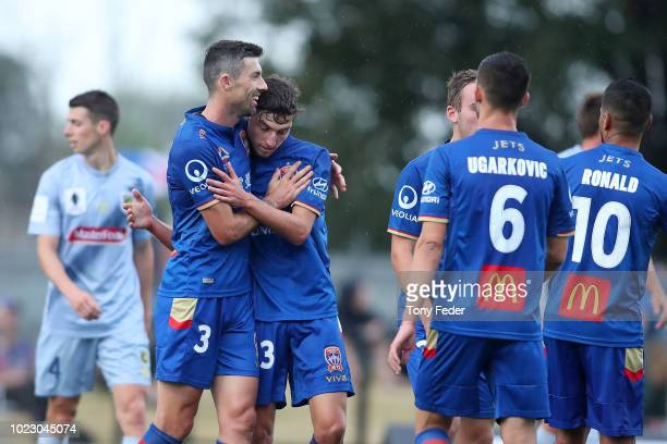 Jets players celebrate a goal during the ALeague trial match between the Newcastle Jets and the Central Coast Mariners at Maitland No1 Sportsground...