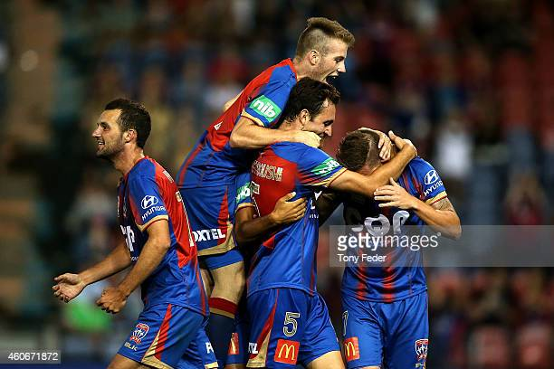 Jets players celebrate a goal during the round 12 A-League match between the Newcastle Jets and Adelaide United at Hunter Stadium on December 19,...