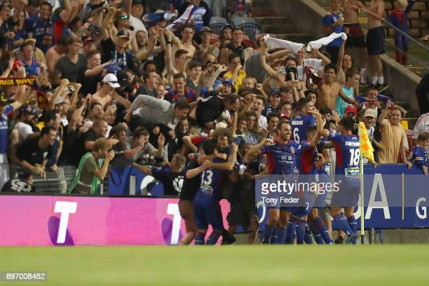Jets players celebrate a goal during the round 12 A-League match between the Newcastle Jets and the Western Sydney Wanderers at McDonald Jones...