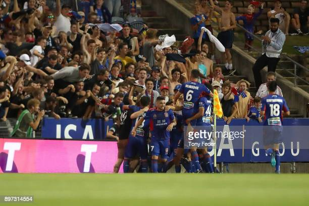 Jets players celebrate a goal during the round 12 ALeague match between the Newcastle Jets and the Western Sydney Wanderers at McDonald Jones Stadium...