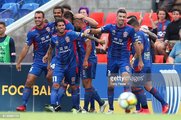Jets players celebrate a goal during the round 19 ALeague match between the Newcastle Jets and the Melbourne Victory at McDonald Jones Stadium on...