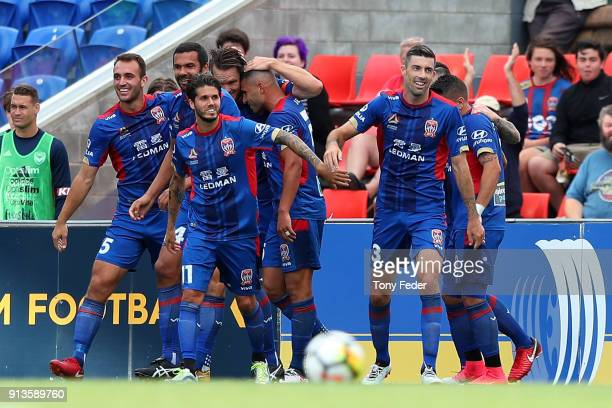 Jets players celebrate a goal during the round 19 A-League match between the Newcastle Jets and the Melbourne Victory at McDonald Jones Stadium on...