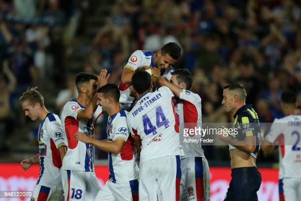 Jets players celebrate a goal during the round 27 ALeague match between the Central Coast Mariners and the Newcastle Jets at Central Coast Stadium on...