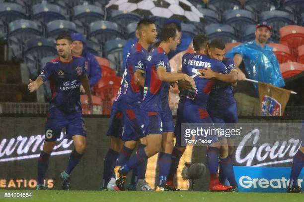 Jets players celebrate a goal during the round nine A-League match between the Newcastle Jets and Melbourne City at McDonald Jones Stadium on...