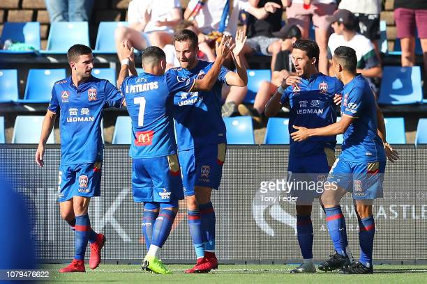 Jets players celebrate a goal during the round seven ALeague match between the Newcastle Jets and the Brisbane Roar at McDonald Jones Stadium on...