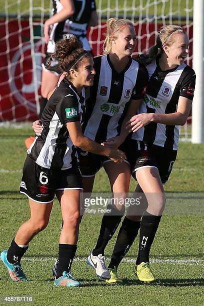 Jets players celebrate a goal during the round two WLeague match between the Newcastle Jets and the Perth Glory at Magic Park on September 20 2014 in...