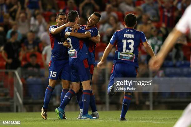 Jets players celebrate a goal from Jason Hoffman during the round 12 ALeague match between the Newcastle Jets and the Western Sydney Wanderers at...