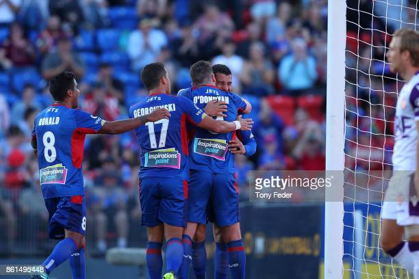 Jets players celebrate a goal with teammate Roy O'Donovan during the round two ALeague match between the Newcastle Jets and the Perth Glory at...