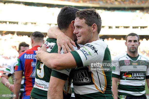 Jets players celebrate after winning the 2015 State Championship Grand Final match between Ipswich Jets and the Newcastle Knights at ANZ Stadium on...