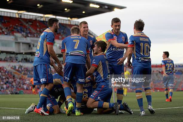 Jets players celebrate their third goal during the round two ALeague match between the Newcastle Jets and the Brisbane Roar at Hunter Stadium on...