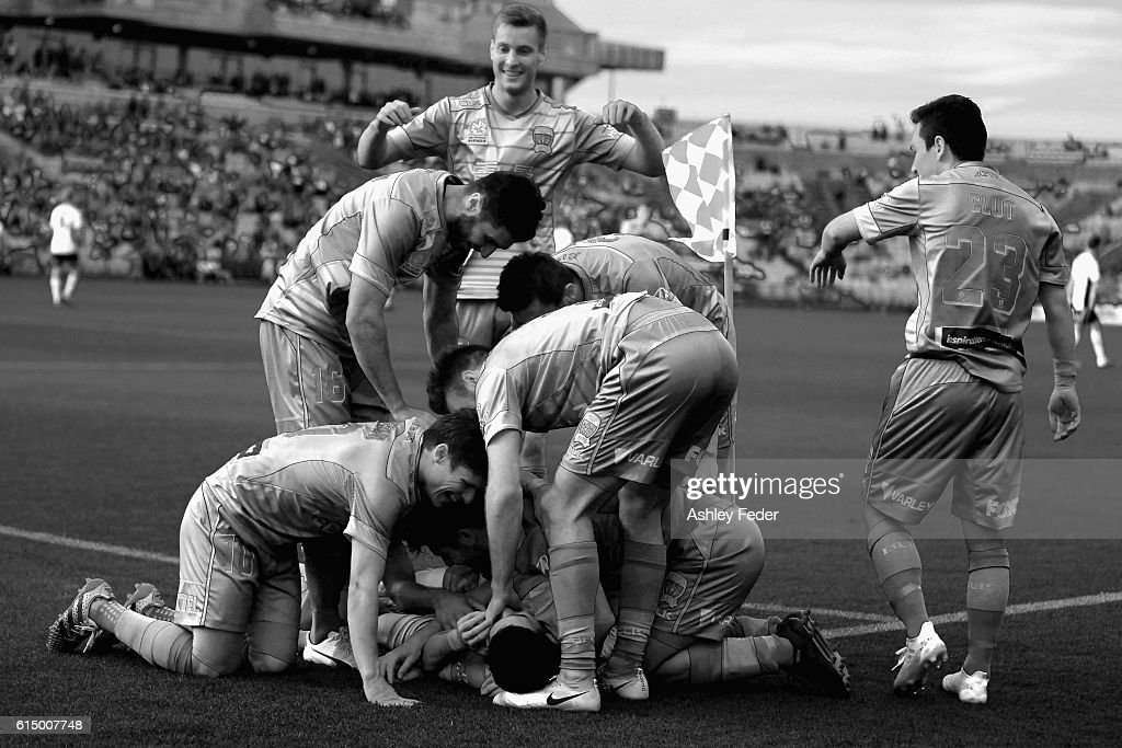 Jets players celebrate their third goal during the round two A-League match between the Newcastle Jets and the Brisbane Roar at Hunter Stadium on October 16, 2016 in Newcastle, Australia.