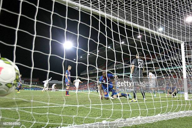 Jets players concede a late goal in injury time during the round 16 A-League match between the Newcastle Jets and Brisbane Roar at Hunter Stadium on...