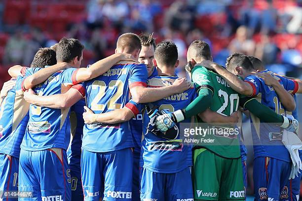 Jets players huddle before the game during the round two ALeague match between the Newcastle Jets and the Brisbane Roar at Hunter Stadium on October...
