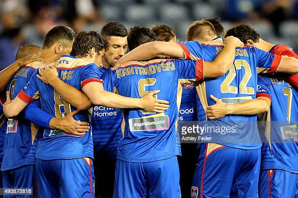 Jets players huddle before the round three ALeague match between the Newcastle Jets and the Melbourne Victory at Hunter Stadium on October 23 2015 in...