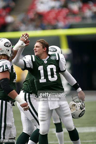 Jets Quarterback Chad Pennington gives high fives as the team comes off the field in their 31 to 24 win over the Lions at the Meadowlands in East...