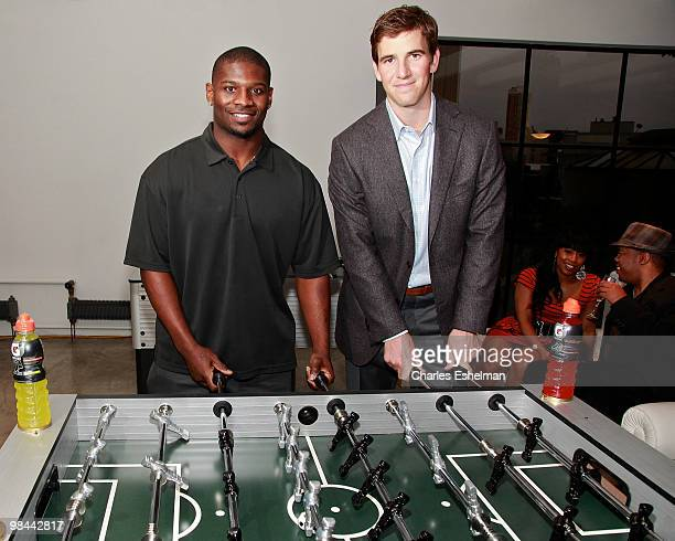 Jets running back Ladainian Tomlinson and NY Giants quarterback Eli Manning attend the launch of G Series Pro by Gatorade at 40 Renwick Street on...