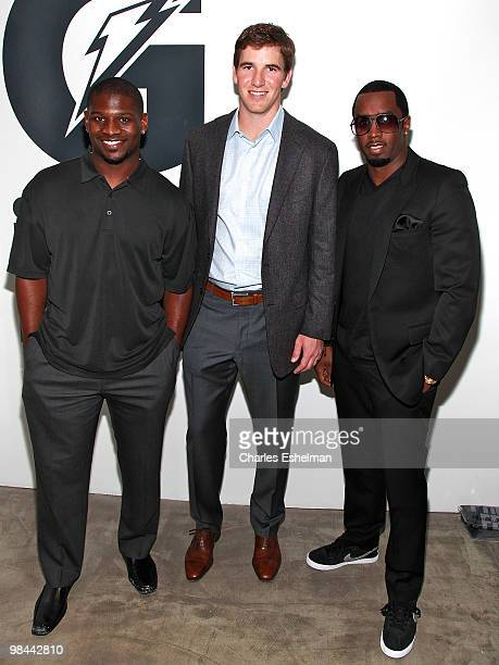 NY Jets running back Ladainian Tomlinson NY Giants quarterback Eli Manning and record producer Sean Diddy Combs attend the launch of G Series Pro by...