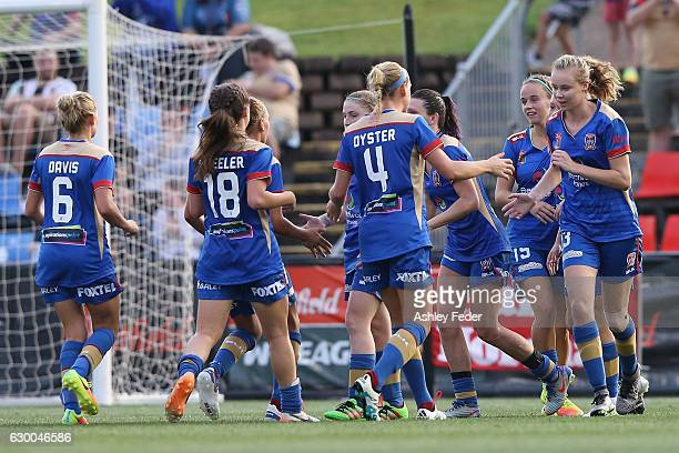 Jets team mates celebrate a goal during the round seven WLeague match between Newcastle and Melbourne at McDonald Jones Stadium on December 16 2016...