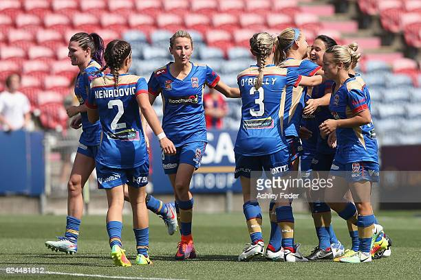 Jets team mates celebrate a goal during the round three WLeague match between the Newcastle Jets and Perth Glory at Hunter Stadium on November 20...