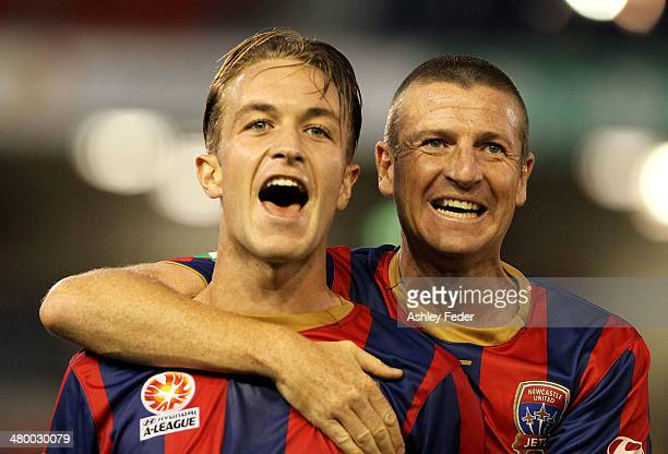 Jets teammates Adam Taggart and Michael Bridges celebrate after winning 50 during the round 24 ALeague match between the Newcastle Jets and...