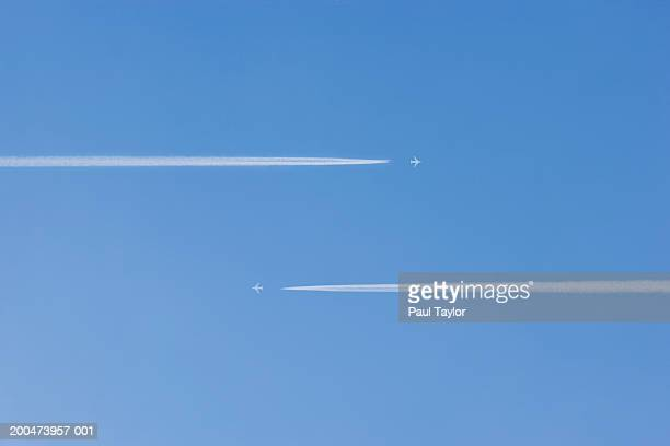 jets vapour trails flying past each other (digital enhancement) - moving past stock pictures, royalty-free photos & images