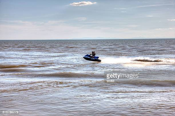 jetski riders bouncing over the waves - cap d'agde stock photos and pictures