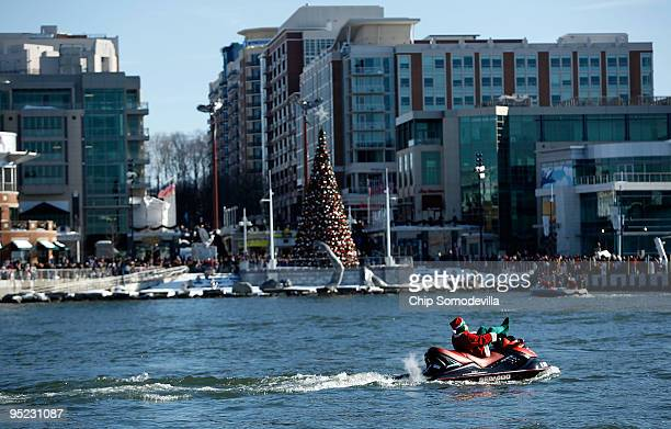 """Jet-Skiing Grinch"""" cruises on the Potomac River December 24, 2009 in National Harbor, Maryland. This is the 22nd anniversary of the aquatic Christmas..."""
