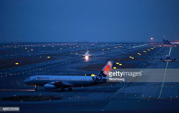 A Jetstar Japan Co aircraft front taxies at Kansai International Airport operated by New Kansai International Airport Co at night in Izumisano City...