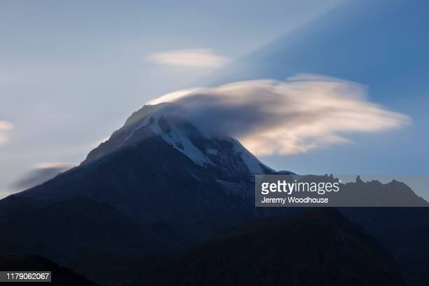 jetstream blowing off the top of mt kazbegi - jetstream stock pictures, royalty-free photos & images