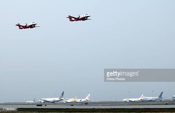 Jetstream J41 aircrafts fly in a demonstration during the Government Flying Service Open Day on November 18 2007 in Hong Kong China Flying...
