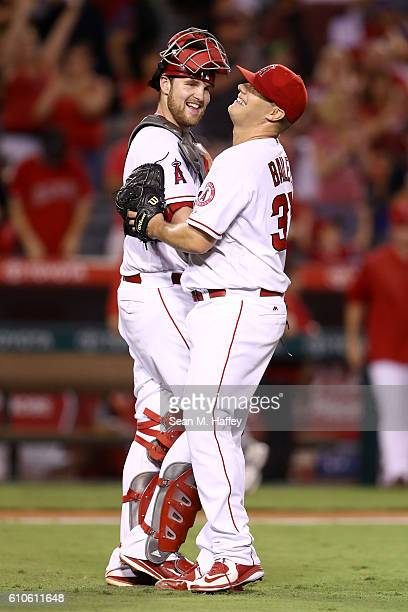 Jett Bandy celebrates with Andrew Bailey of the Los Angeles Angels of Anaheim after defeating the Oakland Athletics 21 in a game at Angel Stadium of...