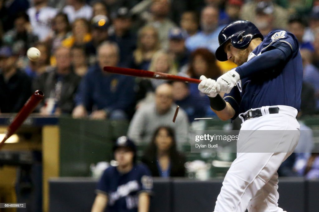 Jett Bandy #47 of the Milwaukee Brewers breaks his bat while hitting a single in the fourth inning against the Colorado Rockies at Miller Park on April 4, 2017 in Milwaukee, Wisconsin.