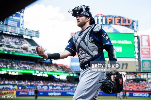 Jett Bandy of the Milwaukee Brewers flips the ball into the stands during the game against the New York Mets at Citi Field on Thursday June 1 2017 in...