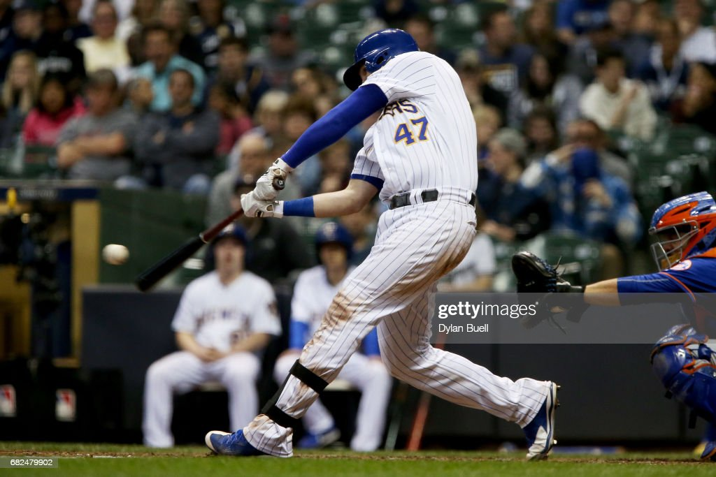 Jett Bandy #47 of the Milwaukee Brewers hits a home run in the seventh inning against the New York Mets at Miller Park on May 12, 2017 in Milwaukee, Wisconsin.