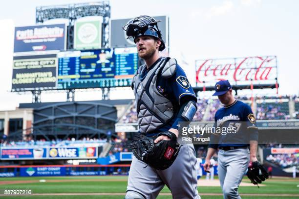 Jett Bandy of the Milwaukee Brewers jogs back to the dugout during the game against the New York Mets at Citi Field on Thursday June 1 2017 in the...