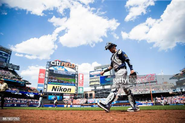 Jett Bandy of the Milwaukee Brewers walks back to the dugout during the game against the New York Mets at Citi Field on Thursday June 1 2017 in the...